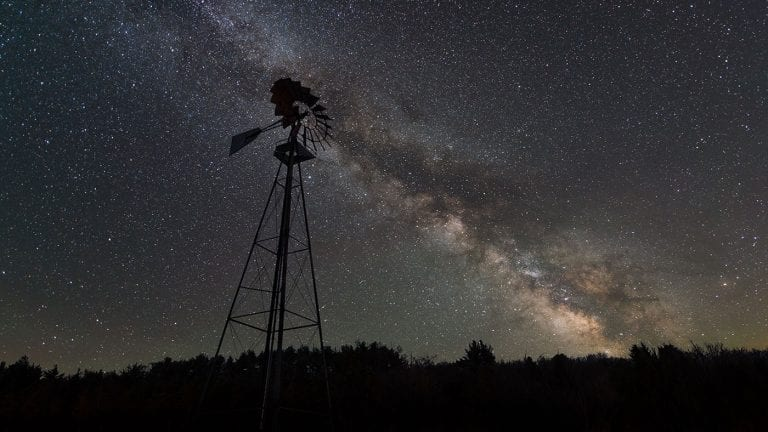 Milky Way behind an old windmill silhouette